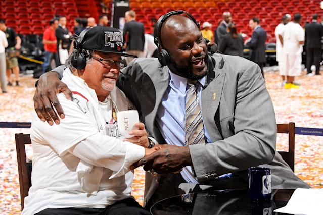 MIAMI, FL - JUNE 20: Micky Arison, owner of the Miami Heat, hugs former NBA player Shaquille O'Neal during an interview following the Heat's victory against the San Antonio Spurs in Game Seven of the 2013 NBA Finals on June 20, 2013 at American Airlines Arena in Miami, Florida. (Photo by Noah Graham/NBAE via Getty Images)