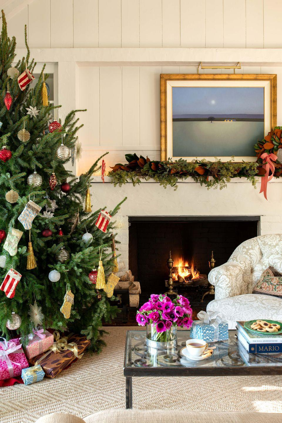 """<p>An easy way to tie your mantel and tree together? Incorporate the same color ribbon on both. The stunning coral bow made of ribbon on this mantel by <a href=""""https://www.housebeautiful.com/design-inspiration/house-tours/a34609190/elizabeth-pash-locust-valley-home-tour/"""" rel=""""nofollow noopener"""" target=""""_blank"""" data-ylk=""""slk:Elizabeth Pash"""" class=""""link rapid-noclick-resp"""">Elizabeth Pash</a> would look even better woven around the tree near it.</p>"""