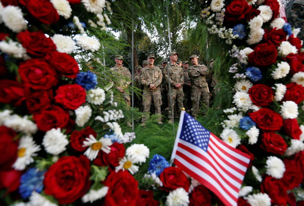 <p>U.S. soldiers take part in a memorial ceremony to commemorate the16th anniversary of the 9/11 attacks, in Kabul, Afghanistan September 11, 2017. (Photo: Mohammad Ismail/Reuters) </p>