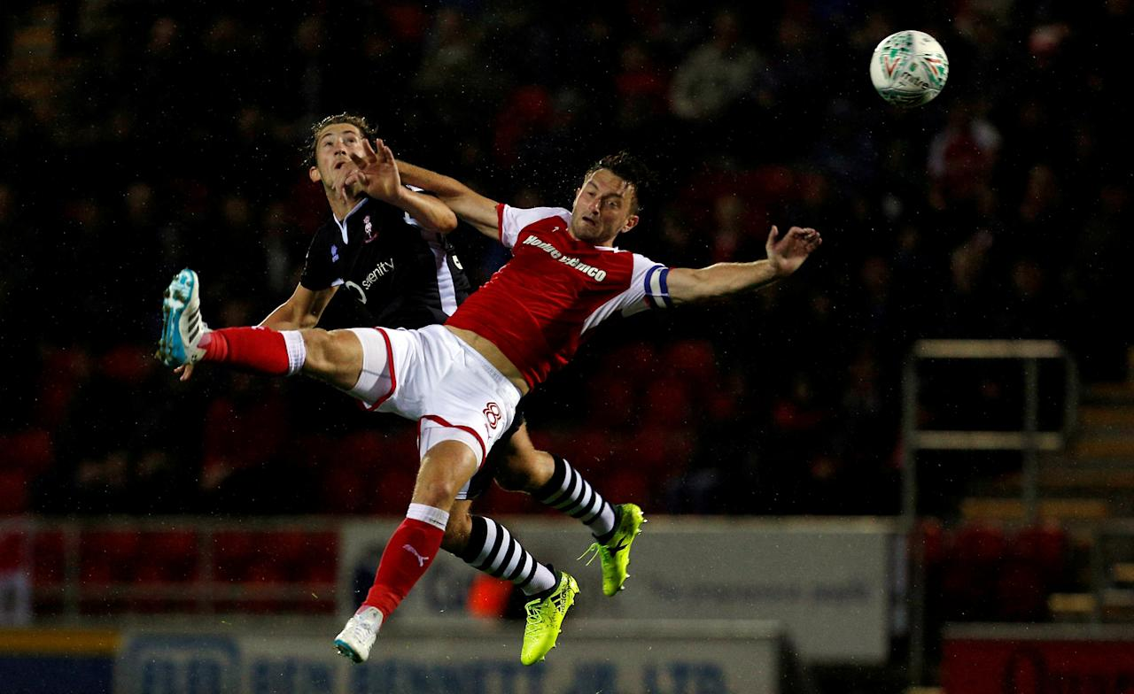 Soccer Football - Carabao Cup First Round - Rotherham United vs Lincoln City - Rotherham, Britain - August 8, 2017  Lincoln City's Alex Woodyard in action with Rotherham United's Lee Frecklington    Action Images/Craig Brough     TPX IMAGES OF THE DAY