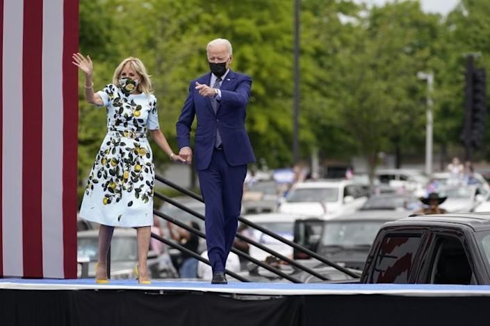President Joe Biden and first lady Jill Biden arrive for a rally at Infinite Energy Center, to mark his 100th day in office, Thursday, April 29, 2021, in Duluth, Ga. (AP Photo/Evan Vucci)