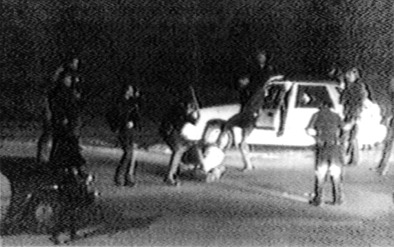 FILE - This March 3, 1991 file video tape shot by George Holliday shows what appears to be a group of police officers beating Rodney King with nightsticks and kicking him as other officers look on. Thursday, March 3, 2011, marks the 20th Anniversary of the video taped beating. Los Angeles Police Chief Charlie Beck says his department has gone through sweeping reforms since the 1991 Rodney King beating, and he doesn't think his officers would engage in such a videotaped assault today.