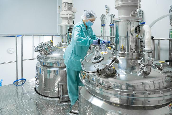 A technician in a pharmaceutical manufacturing facility.