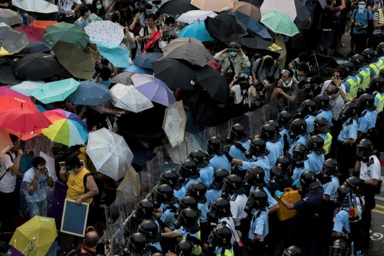 The Occupy trio urged people to join what became known as the Umbrella Movement as protesters used umbrellas to shield themselves from tear gas and pepper spray