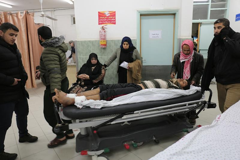 An injured Palestinian man arrives at a hospital to receive treatment following an Israeli air strike in the southern Gaza Strip (AFP Photo/SAID KHATIB)