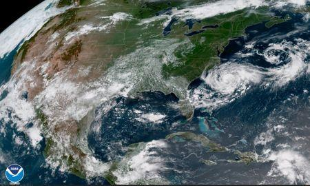 Tropical Storm Chris is shown off the eastern coast of North and South Carolina, U.S., in this satellite image July 9, 2018 at 16:12 UTC.  NOAA/Goes-East Imagery/Handout via REUTERS