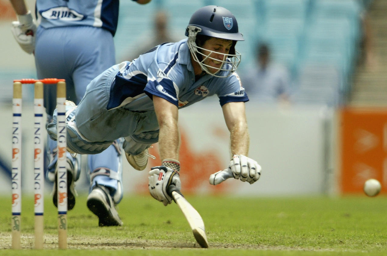 SYDNEY - FEBRUARY 16:  Simon Katich of the Blues dives for the crease during the ING Cup cricket match between the New South Wales Blues and the South Australian Redbacks at Telstra Stadium in Sydney, February 16, 2003 in Sydney, Australia. (Photo by Daniel Berehulak/Getty Images)