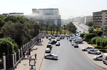 Ambulances and security vehicles are seen near the headquarters of Libyan state oil firm National Oil Corporation (NOC) after three masked persons attacked it in Tripoli, Libya September 10, 2018. REUTERS/Hani Amara