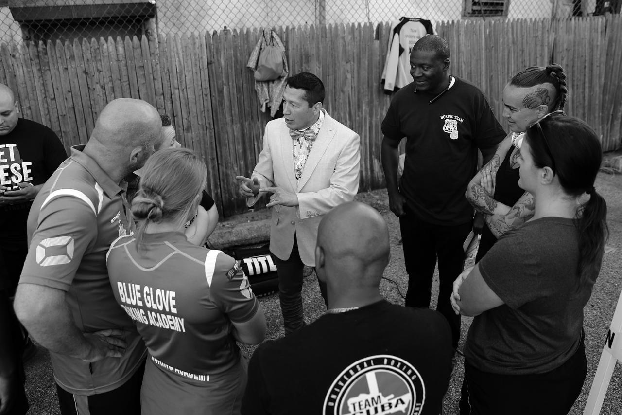 <p>President of NYPD Fighting Finest Boxing Team Dave Siev gives instruction to staff and visiting boxers at the 'Brooklyn Smoker' in the parking lot of Gargiulo's Italian Restaurant in Coney Island, Brooklyn on Aug. 23, 2018. (Photo: Gordon Donovan/Yahoo News) </p>