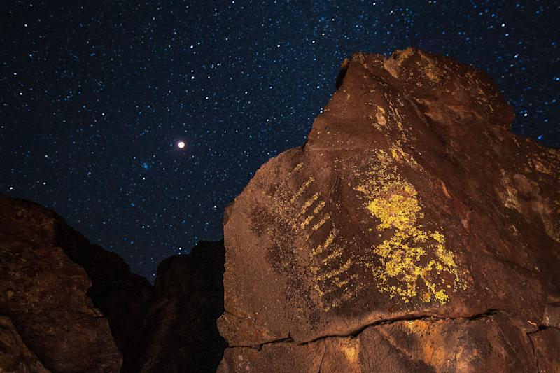 The total lunar eclipse and supermoon over ancient Native American petroglyphs on Jan. 20, near Barstow, California.