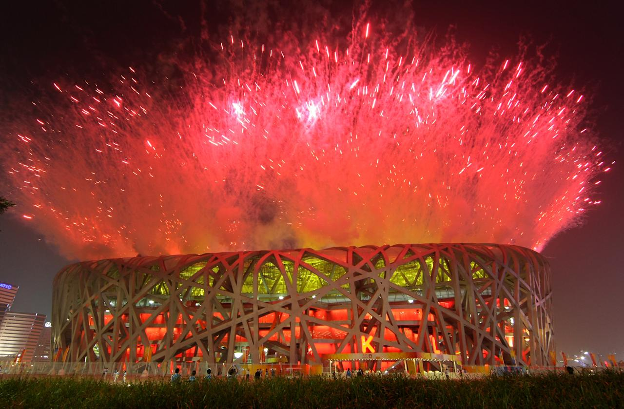 BEIJING - AUGUST 08:  Fireworks explode over the National Stadium during the Opening Ceremony for the 2008 Beijing Summer Olympics on August 8, 2008 in Beijing, China.  (Photo by Stu Forster/Getty Images)