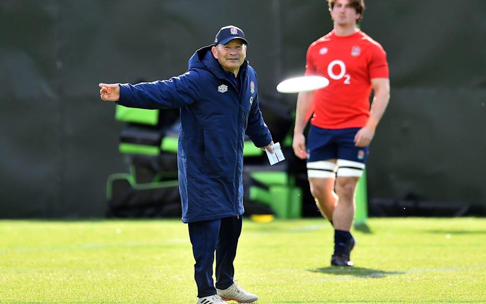 England head coach Eddie Jones plays with a frisbee during the training session at The Lensbury Hotel - PA