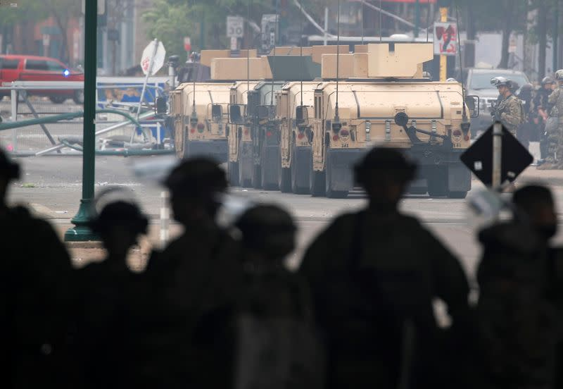 Armoured vehicles are pictured as National Guard members guard the area in the aftermath of a protest, in Minneapolis