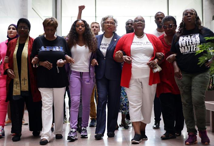 """<span class=""""caption"""">Voting rights activists protest voter restriction laws being passed in states across the country, in Washington, D.C., July 15, 2021. </span> <span class=""""attribution""""><a class=""""link rapid-noclick-resp"""" href=""""https://www.gettyimages.com/detail/news-photo/voting-rights-activists-led-by-u-s-rep-joyce-beatty-and-news-photo/1328936506?adppopup=true"""" rel=""""nofollow noopener"""" target=""""_blank"""" data-ylk=""""slk:Alex Wong/Getty Images"""">Alex Wong/Getty Images</a></span>"""