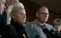 Charlotte Charles, mother of Harry Dunn, who died after his motorbike was involved in an August 2019 accident in Britain with Anne Sacoolas, wife of an American diplomat, speaks at a news conference as she is joined by Dunn's father Tim Dunn, center right, and other family members and supporters Monday, Oct. 14, 2019, in New York. The family is seeking answers after Sacoolas returned to the United States after being granted diplomatic immunity following the crash. (AP Photo/Craig Ruttle)