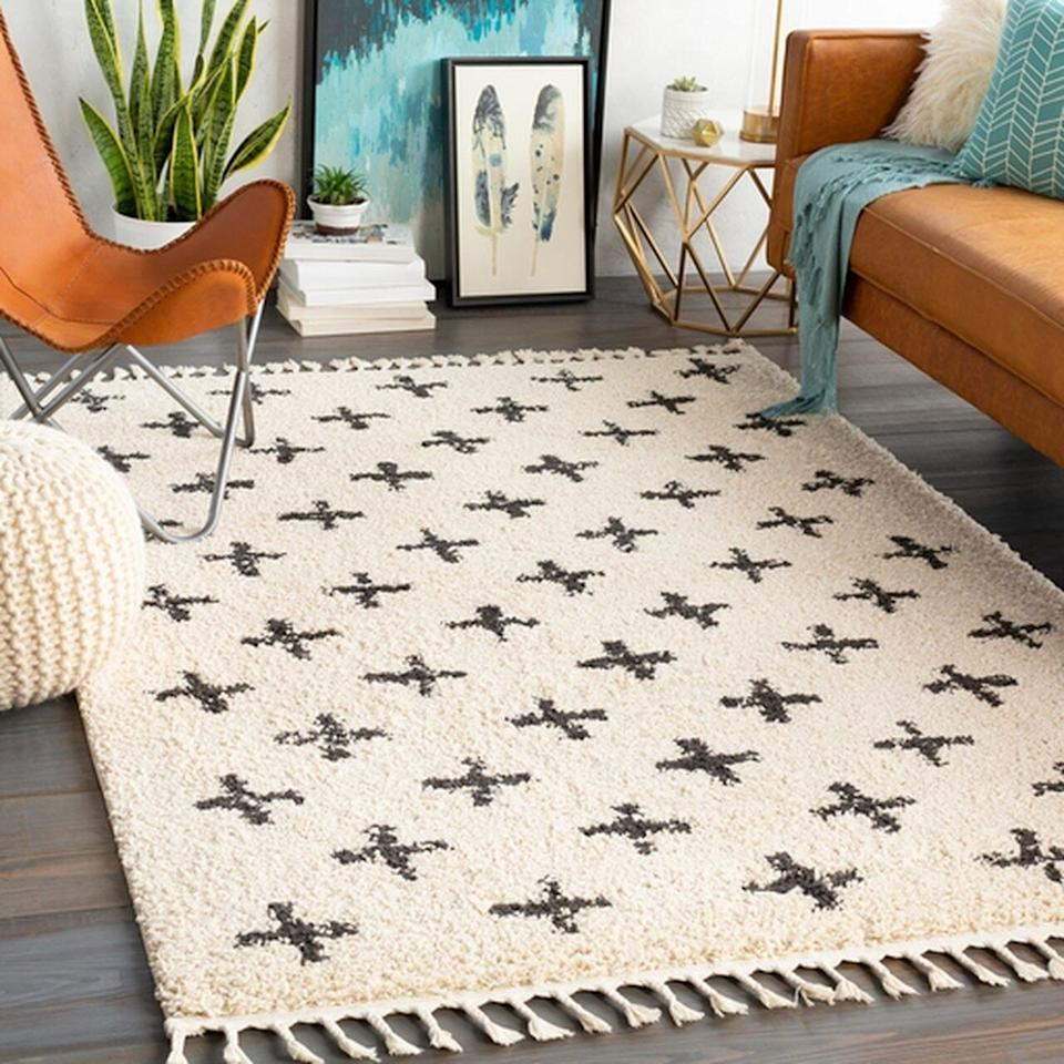 """Add this to the floor in your living room or even your bedroom to add some warmth and comfort to the room. Your feet will thank you later when you get up from the couch and don't have to touch your cold hardwood floor.<strong><br /><br />Promising review:</strong>""""This is softer than I anticipated and I'm really enjoying the tassels. It's good quality."""" — Michael J.<br /><br /><strong>Get it from Boutique Rugs for<a href=""""https://go.skimresources.com?id=38395X987171&xs=1&url=https%3A%2F%2Fboutiquerugs.com%2Falstead-area-rug%2F&xcust=HPHomeMagazine609acebfe4b099ba752f64c2"""" target=""""_blank"""" rel=""""nofollow noopener noreferrer"""" data-skimlinks-tracking=""""5854435"""" data-vars-affiliate=""""ShareASale"""" data-vars-asin=""""none"""" data-vars-campaign=""""SHOPMagazineHomeMower2-2-2021--5854435-"""" data-vars-href=""""https://shareasale.com/r.cfm?afftrack=SHOPMagazineHomeMower2-2-2021--5854435-&b=999&m=80189&u=1615998&urllink=boutiquerugs.com%2Falstead-area-rug%2F"""" data-vars-link-id=""""16331382"""" data-vars-price="""""""" data-vars-product-id=""""1"""" data-vars-product-img=""""none"""" data-vars-product-title=""""Placeholder- no product"""" data-vars-redirecturl=""""boutiquerugs.com/alstead-area-rug/"""" data-vars-retailers="""""""" data-ml-dynamic=""""true"""" data-ml-dynamic-type=""""sl"""" data-orig-url=""""https://shareasale.com/r.cfm?afftrack=SHOPMagazineHomeMower2-2-2021--5854435-&b=999&m=80189&u=1615998&urllink=boutiquerugs.com%2Falstead-area-rug%2F"""" data-ml-id=""""27"""">$29.85+</a>(available in six sizes).</strong>"""