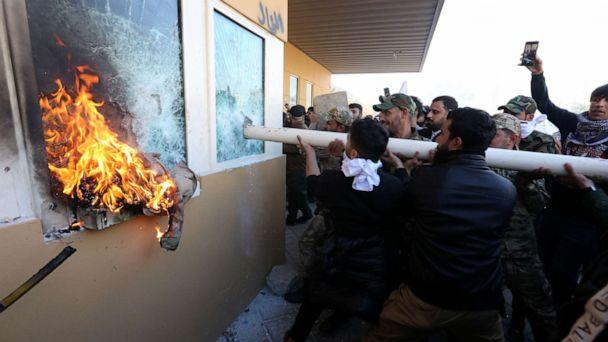 PHOTO: Members of Iraqi Shiite 'Popular Mobilization Forces' armed group and their supporters attack the entrance of the US Embassy in Baghdad, Iraq, Dec. 31, 2019. (Ahmed Jalil/EPA via Shutterstock)