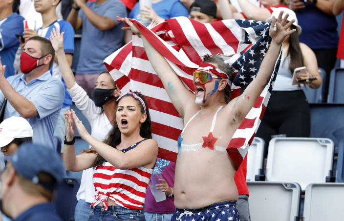 Fans celebrate the United States' 1-0 win over Canada in a CONCACAF Gold Cup soccer match in Kansas City, Kan., Sunday, July 18, 2021. (AP Photo/Colin E. Braley)