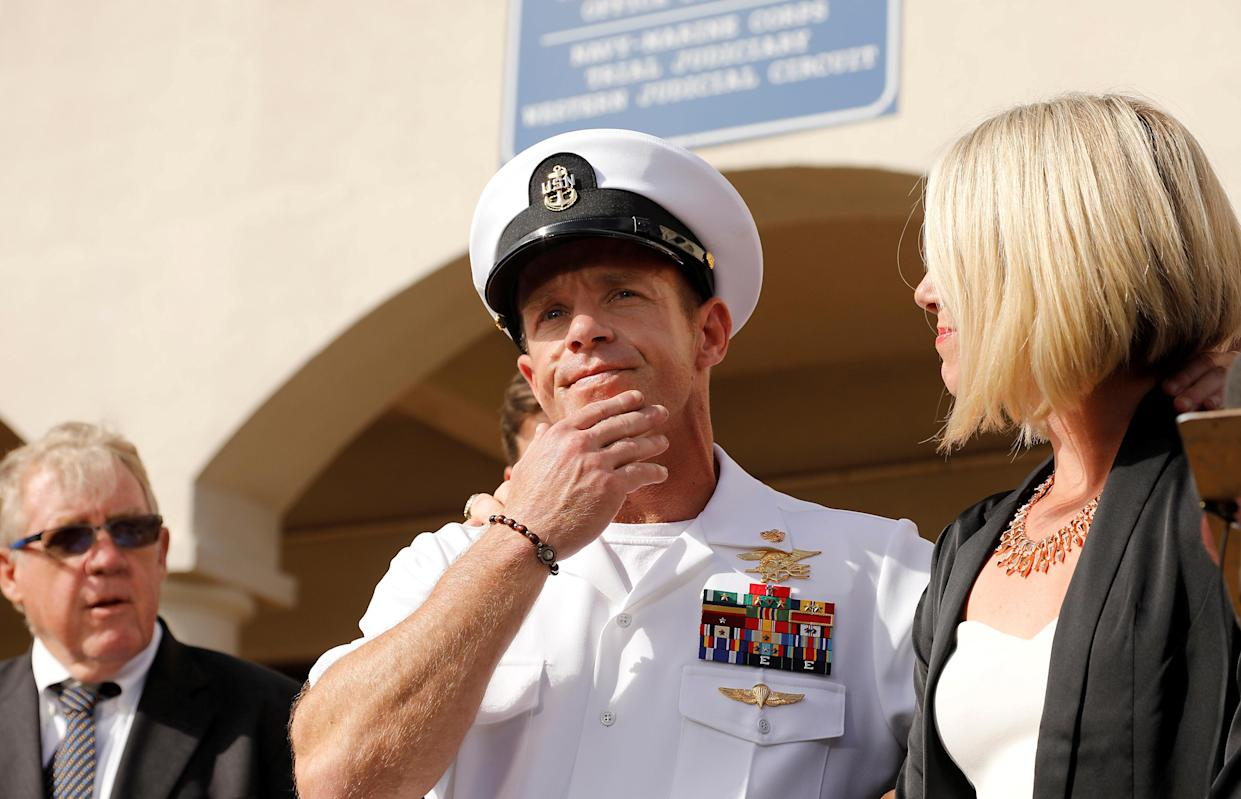 Eddie Gallagher prepares to answer a question from the media with wife Andrea Gallagher at Naval Base San Diego on July 2. (Photo: John Gastaldo/Reuters)