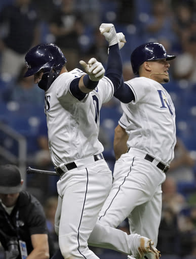 Tampa Bay Rays' Mike Zunino, left, celebrates with Willy Adames after Zunino hit a home run off Kansas City Royals pitcher Tim Hill during the sixth inning of a baseball game Tuesday, April 23, 2019, in St. Petersburg, Fla. (AP Photo/Chris O'Meara)