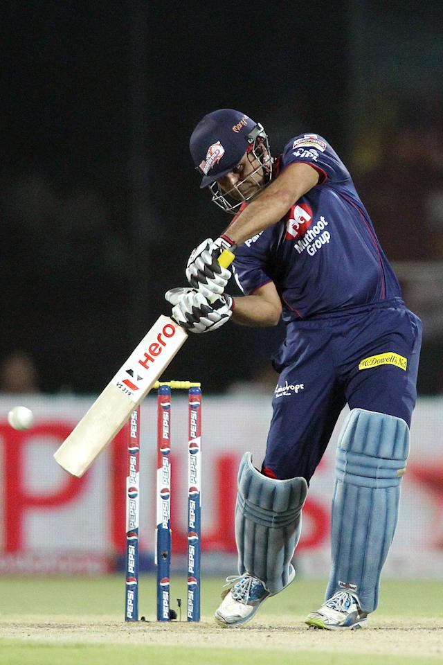 Virender Sehwag of Delhi Daredevils attacks a delivery during match 57 of the Pepsi Indian Premier League between Delhi Daredevils and the Royal Challengers Bangalore held at the Feroz Shah Kotla Stadium, Delhi on the 10th May 2013. (BCCI)
