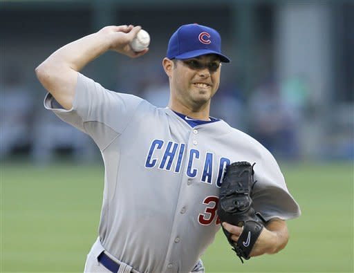 Chicago Cubs starting pitcher Randy Wells delivers during the first inning of an interleague baseball game against the Chicago White Sox, Wednesday, June 20, 2012, in Chicago. (AP Photo/Charles Rex Arbogast)