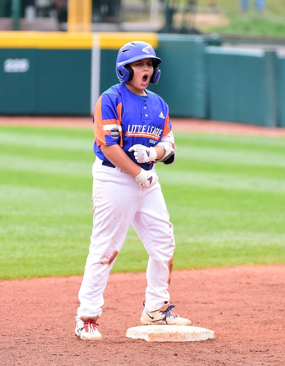 Aug 29, 2021; Williamsport, PA, USA; Great Lakes Region (Michigan) third baseman Jackson Surma (22) reacts after hitting a two run double in the first inning against Great Lakes Region (Ohio) during the Little League World Series Championship game at Howard J. Lamade Stadium. Mandatory Credit: Evan Habeeb-USA TODAY Sports