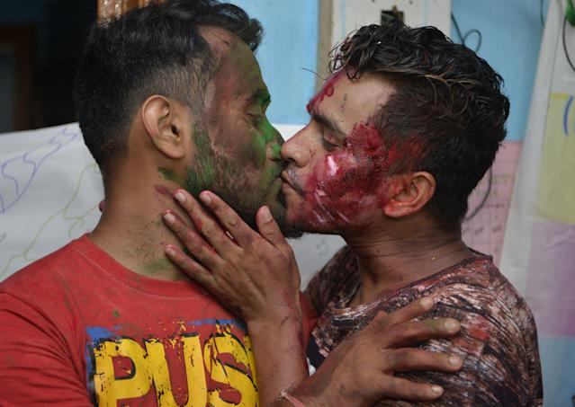 <p>Indian members and supporters of the lesbian, gay, bisexual, transgender (LGBT) community celebrate the Supreme Court decision to strike down a colonial-era ban on gay sex, in Siliguri on September 6, 2018. – India's Supreme Court on September 6 struck down the ban that has been at the centre of years of legal battles. (Photo by DIPTENDU DUTTA/AFP/Getty Images) </p>