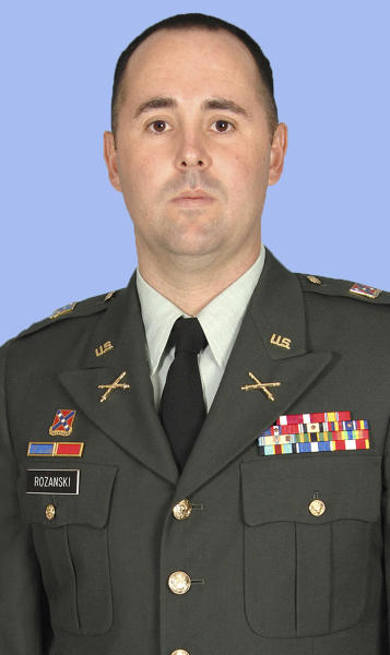 This undated photo provided by the Ohio National Guard shows Capt. Nicholas Rozanski. The U.S. Defense Department says Rozanski was among three members of the same Columbus-based National Guard unit killed in the Wednesday attack in Maimanah, the capital of Faryab province, in Afghanistan. (AP Photo/Ohio National Guard)