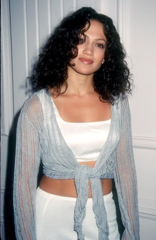 <p>Lopez attended an event in 1996 with glossy lips and her natural curls.</p>