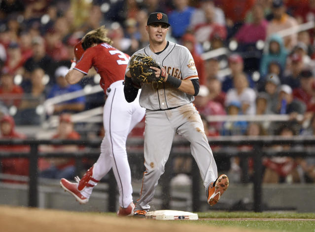 Washington Nationals' Bryce Harper, back, is put out at first by San Francisco Giants third baseman Ryder Jones during the first inning of a baseball game, Saturday, Aug. 12, 2017, in Washington. Harper was injured on the play. (AP Photo/Nick Wass)