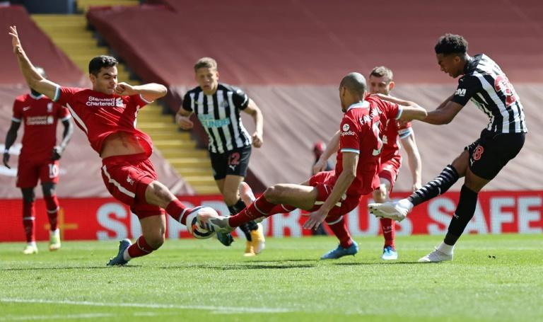 Joe Willock (right) struck in stoppage time to earn Newcastle a 1-1 draw at Liverpool