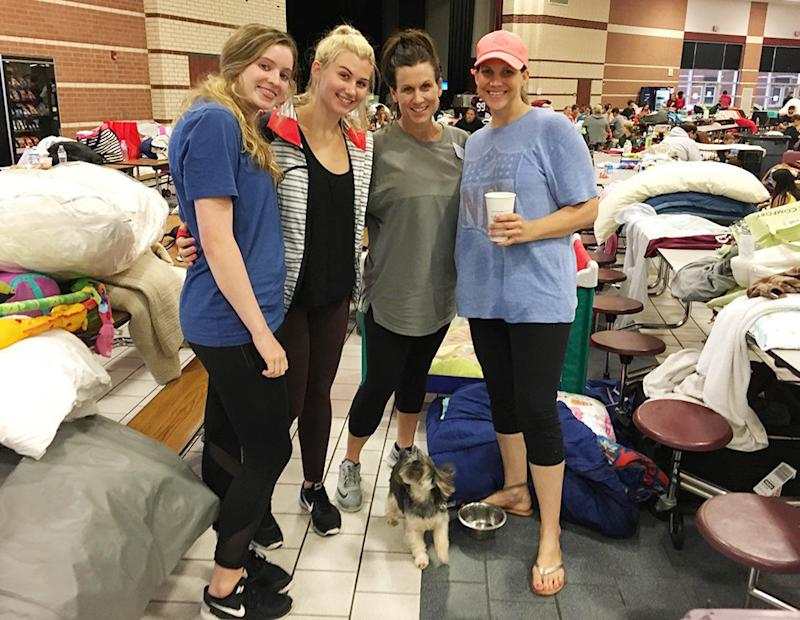 Avery Butler, 17, left, Lauren Irving, 17, Whitney Irving, 45, and Jen Guidry, 37, make the best of their time as evacuees at Cinco Ranch High School in Katy, Texas.