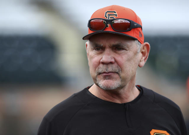 "FILE - In this Feb. 19, 2018 file photo, San Francisco Giants manager Bruce Bochy oversees a spring training baseball practice in Scottsdale, Ariz. ""You talk to the players and you can see a different attitude coming into this spring with what's happened this offseason,"" manager Bruce Bochy said. ""And also the fact that it's a new slate and we're going to be healthy, so there's a lot of reason to be optimistic."" (AP Photo/Ben Margot, File)"