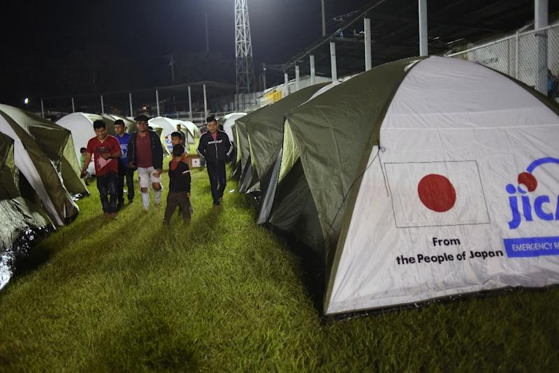 Residents of several communities located near the erupting Fuego volcano were housed in tents in Escuintla on November 19, 2018 (AFP Photo/Johan ORDONEZ)