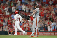 San Francisco Giants starting pitcher Dereck Rodriguez, right, stands off the mound as St. Louis Cardinals' Marcell Ozuna, left, rounds the bases after hitting a solo home run during the sixth inning of a baseball game Tuesday, Sept. 3, 2019, in St. Louis. (AP Photo/Jeff Roberson)