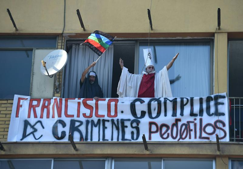 People demonstrate againstPope Francis' visit to Chile on January 16, 2018. (EITAN ABRAMOVICH via Getty Images)