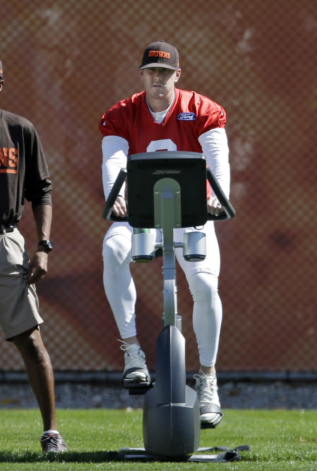 Cleveland Browns quarterback Brandon Weeden rides an exercise bile during practice at the NFL football team's facility in Berea, Ohio Wednesday, Sept. 25, 2013. Head coach Rob Chudzinski said Brian Hoyer will start again Sunday against the Cincinnati Bengals in place of the injured Weeden, who is still recovering from a sprained right thumb. (AP Photo/Mark Duncan)