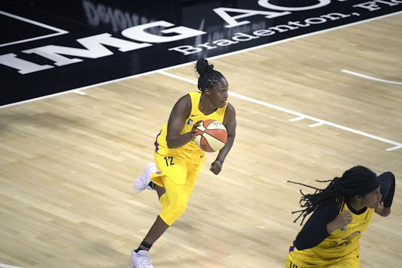 Los Angeles Sparks guard Chelsea Gray (12) brings the ball up the court.