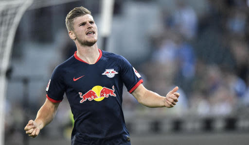 Leipzig's scorer Timo Werner celebrates the second of his three goals during the German Bundesliga soccer match between Borussia Moenchengladbach and RB Leipzig in Moenchengladbach, Germany, Friday, Aug. 30, 2019. (AP Photo/Martin Meissner)