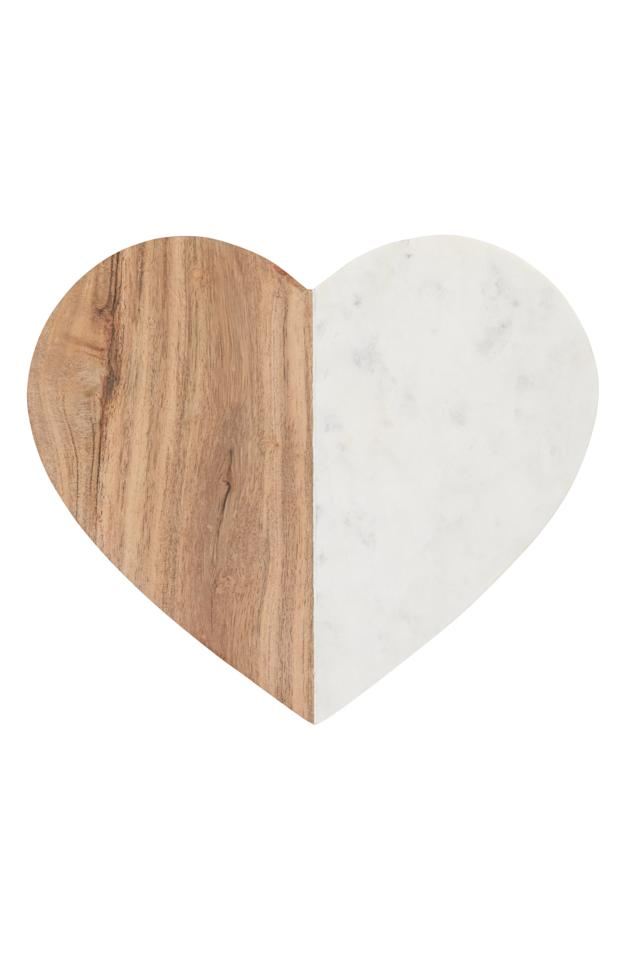 """<p><strong>NORDSTROM AT HOME</strong></p><p>nordstrom.com</p><p><strong>$39.00</strong></p><p><a href=""""https://shop.nordstrom.com/s/nordstrom-at-home-heart-marble-acacia-wood-serving-board/5051052"""" target=""""_blank"""">SHOP NOW</a></p><p>Show Mom how much you love her (and cheese!) with this gorgeous serving board. Just add charcuterie!</p>"""