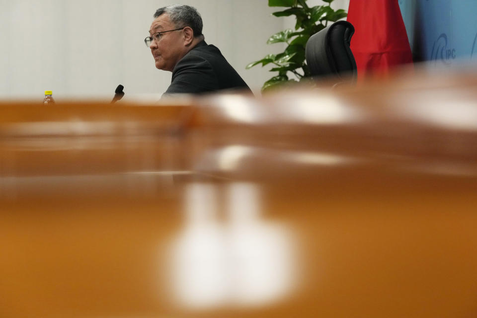 Fu Cong, a Foreign Ministry director general, speaks at a briefing for foreign journalists at the Foreign Ministry in Beijing, China, Wednesday, Aug. 25, 2021. China went on the offensive Wednesday ahead of the release of a U.S. intelligence report on the origins of the coronavirus, bringing out the senior official to accuse the United States of politicizing the issue by seeking to blame China. (AP Photo/Ng Han Guan)