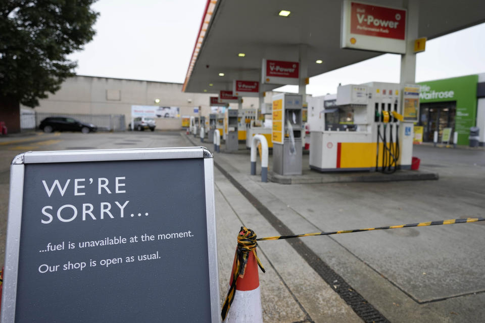 A sign showing the lack of fuel is displayed at the entrance of a petrol station in London, Thursday, Sept. 30, 2021. Many gas stations around Britain have shut down in the past five days after running out of fuel, a situation exacerbated by panic buying among some motorists. Long lines of vehicles formed at pumps that were still open, blocking roads and causing traffic chaos. Some drivers have had to endure hourslong waits to fill up. (AP Photo/Frank Augstein)