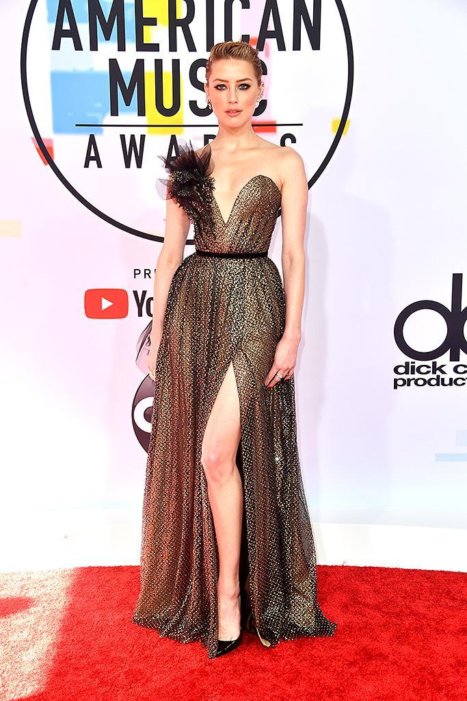 <p>Amber Heard attends the 2018 American Music Awards at Microsoft Theater on Oct. 9, 2018, in Los Angeles. (Photo: Frazer Harrison/Getty Images) </p>