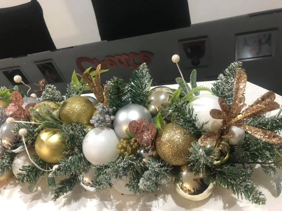 Image of Kmart pool noodle trend arrangement with bronze, gold and silver baubles