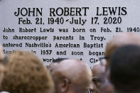 People look at a new historical marker remembering former Rep. John Lewis after it was unveiled Friday, July 16, 2021, in Nashville, Tenn. Earlier this year, Nashville's Metro Council renamed a large portion of Fifth Avenue to Rep. John Lewis Way. (AP Photo/Mark Humphrey)