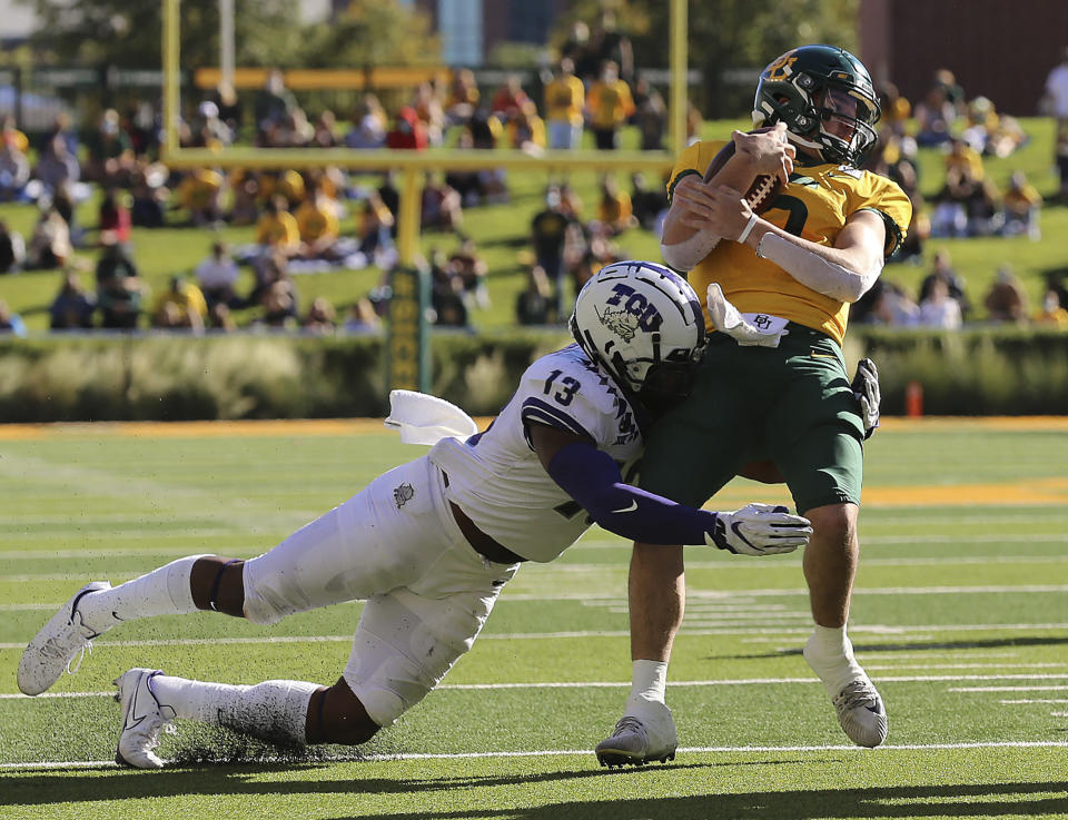 Baylor quarterback Charlie Brewer (5) is tackled by TCU linebacker Dee Winters (13) during the first half of an NCAA college football game in Waco, Texas, Saturday, Oct. 31, 2020. (Jerry Larson/Waco Tribune-Herald via AP)