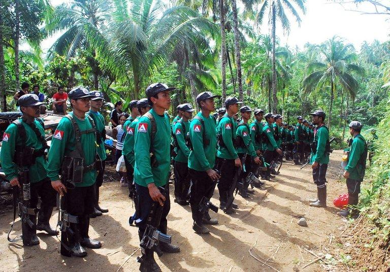 A picture taken on December 26, 2009, shows communist NPA rebels at an unspecified location in the southern Philippines