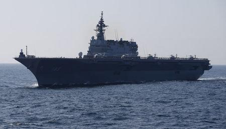 FILE PHOTO : The Izumo military helicopter carrier of the Japan Maritime Self-Defense Force (JMSDF) sails during its fleet review at Sagami Bay, off Yokosuka, south of Tokyo October 18, 2015. REUTERS/Toru Hanai/File Photo