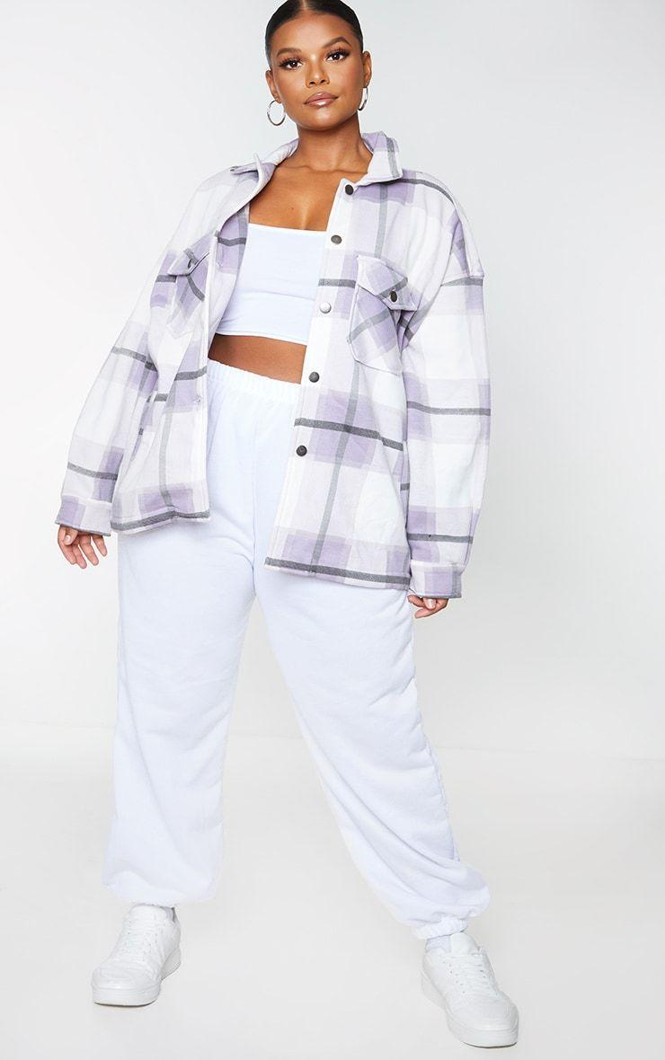 """<p><strong>PRETTYLITTLETHING</strong></p><p>prettylittlething.us</p><p><strong>$37.00</strong></p><p><a href=""""https://go.redirectingat.com?id=74968X1596630&url=https%3A%2F%2Fwww.prettylittlething.us%2Fplus-purple-checked-pocket-front-shacket.html&sref=https%3A%2F%2Fwww.cosmopolitan.com%2Fstyle-beauty%2Ffashion%2Fg36232237%2Fbest-shackets%2F"""" rel=""""nofollow noopener"""" target=""""_blank"""" data-ylk=""""slk:Shop Now"""" class=""""link rapid-noclick-resp"""">Shop Now</a></p><p>This here is proof that you can instantly elevate a sweatsuit look with a good shacket.</p>"""